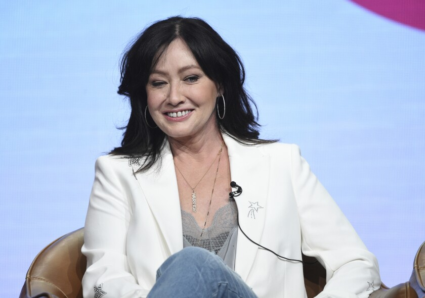 """FILE - Shannen Doherty participates in Fox's """"BH90210"""" panel at the Television Critics Association Summer Press Tour on Aug. 7, 2019, in Beverly Hills, Calif. A federal jury in Los Angeles awarded $6.3 million to actor Shannen Doherty on Monday, Oct. 4, 2021, in a lawsuit alleging that State Farm failed to pay sufficiently for damage to her house in a 2018 California wildfire. (Photo by Chris Pizzello/Invision/AP, File)"""