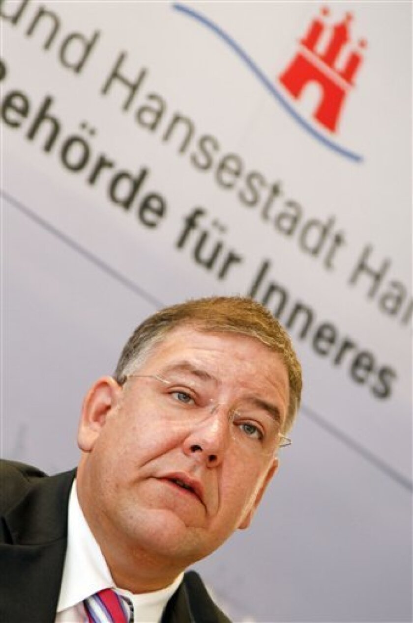 """Christoph Ahlhaus, secretary of interior of the city of Hamburg, speaks during a press conference about the closing of the a mosque and the ban of Arab-German culuture organization """"Taiba""""  in Hamburg, northern Germany, on Monday, Aug.  9, 2010. The Hamburg mosque formerly known as the al-Quds mosq"""