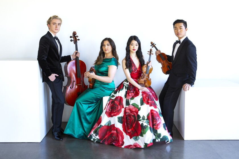 A formal photo of the Viano String Quartet holding instruments