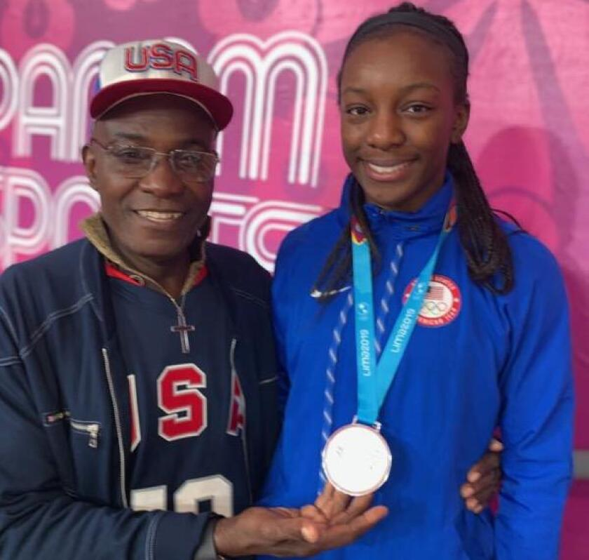 Michaela Onyenwere and her father, Peter, at the Pan Am games this summer in Peru where Michaela helped Team USA to a silver medal.