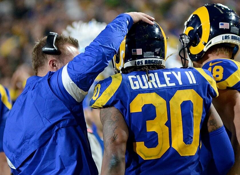 Rams coach Sean McVay congratulates running back Todd Gurley.