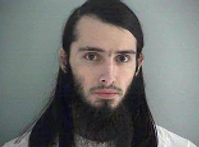 FILE- This Jan. 14, 2015, file photo, made available by the Butler County Jail shows Christopher Lee Cornell. Attorneys for Cornell, an Ohio man accused of plotting to attack the U.S. Capitol, are questioning his mental competence, according to court documents obtained Tuesday, Nov. 3, 2015, by The