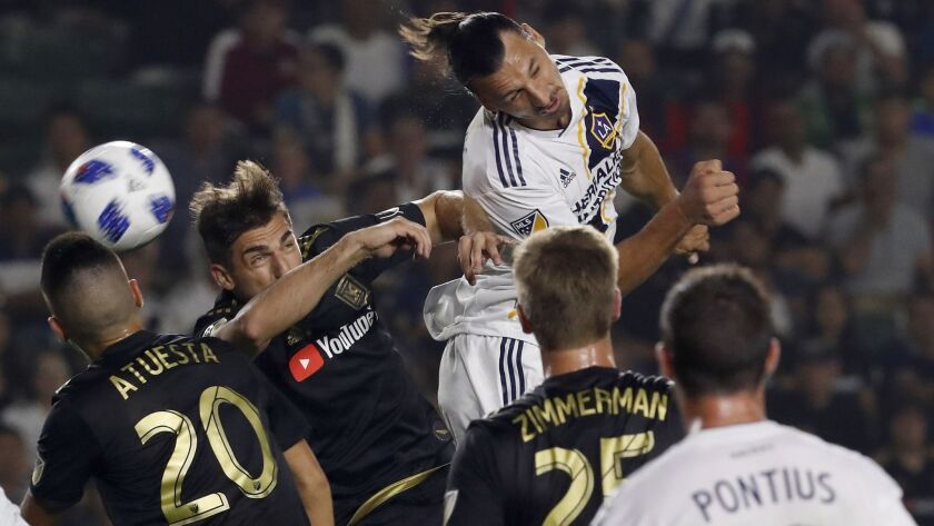 Galaxy forward Zlatan Ibrahimovic tries to head the ball into the LAFC goal during a corner kick in the first half Friday on Aug. 24, 2018 in Carson.