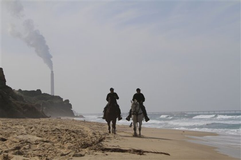 Israeli policemen, riding on horses, patrol along the beach in the southern Israeli town of Ashkelon, near the Gaza border, Tuesday, Feb. 2, 2010. On Monday, at least two barrels full of explosives washed up on Israeli beaches north of Gaza. Israeli media speculated that Hamas was trying to avenge the Hamas commander killing in Dubai, but police would not confirm that. Police safely disposed of the explosives. (AP Photo/Tsafrir Abayov)