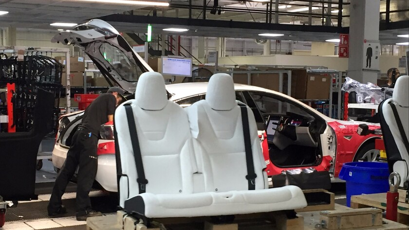 Seats are ready for installation at the Tesla assembly plant in Fremont, Calif.