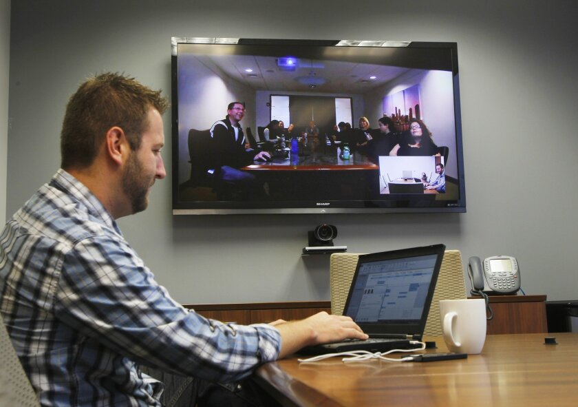 Greg Carlson, who is a senior technical consultant at Commonwealth Financial Network, participates in a teleconference, at the company's offices in San Diego. The meeting was with the company's headquarters in Boston.