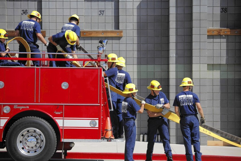Los Angeles Fire Department recruits train at a facility in Panorama City. As part of Thursday's announcement, Garcetti said a new training class scheduled to begin later this year has been canceled.