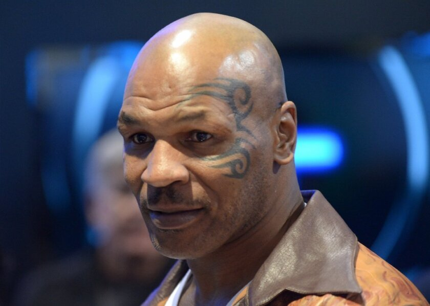 Mike Tyson is being called a hero after he came to the aid of an injured motorcyclist in Las Vegas.