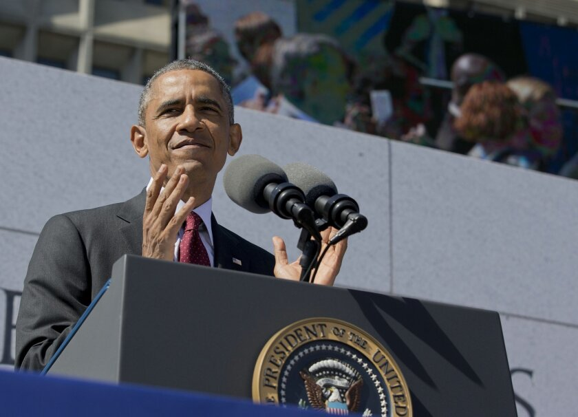 President Barack Obama applauds as he pays tribute to disabled U.S. veterans at the American Veterans Disabled for Life Memorial dedication ceremony in Washington, Sunday, Oct. 5, 2014. (AP Photo/Manuel Balce Ceneta)