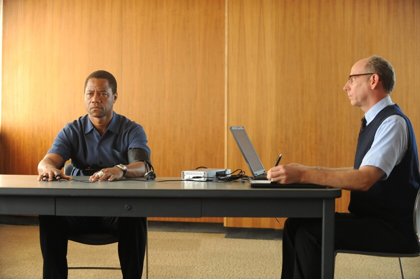 """Cuba Gooding Jr. as O.J. Simpson, left, and Joseph Buttler as a polygraph examiner in """"The People v. O.J. Simpson: American Crime Story."""""""