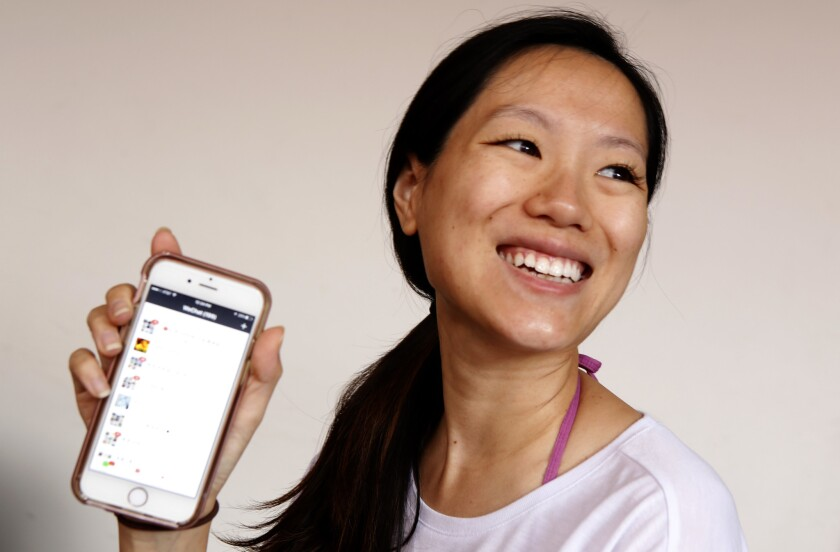 Shirley Zhang with her phone and WeChat. She uses WeChat to purchase dumplings.