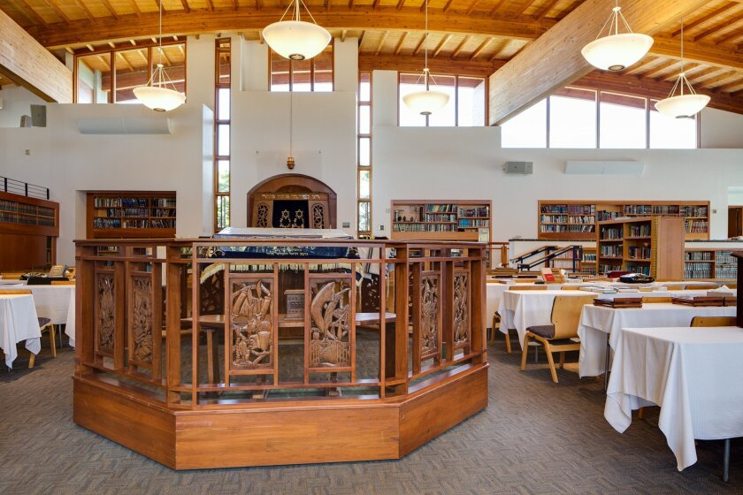 The center of the main room inside Adat Yeshurun includes a bimah (a podium) featuring intricate, wood carvings created by rabbi Jeff Wohlgelernter's father, an artist.
