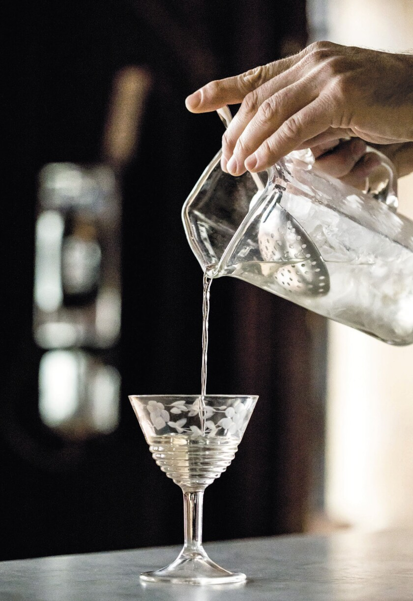 Pouring out a martini