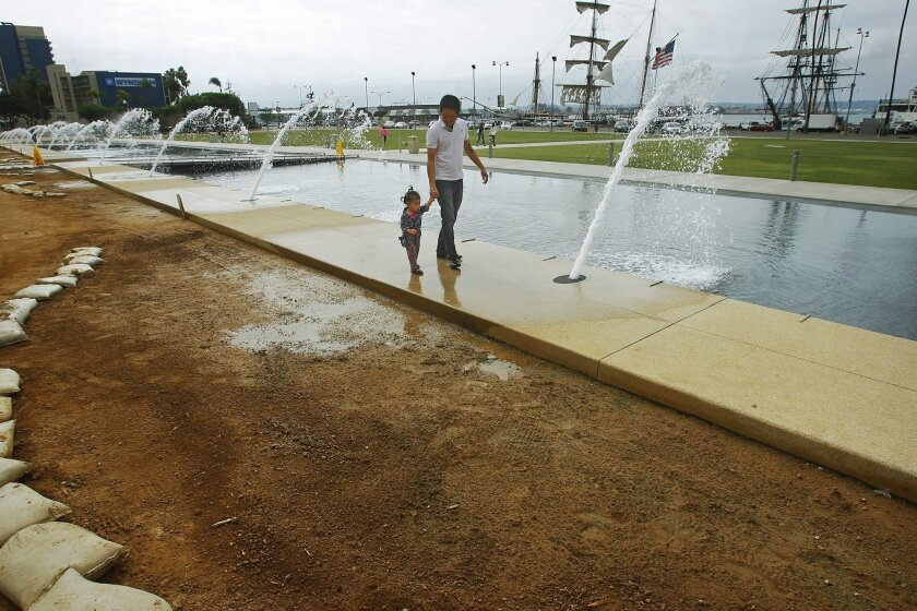 Splash pads and other recreational water features, such as the county's Waterfront Park near San Diego harbor, will not be affected by San Diego's new restrictions on ornamental fountains. / photo by K.C. Alfred * U-T San Diego