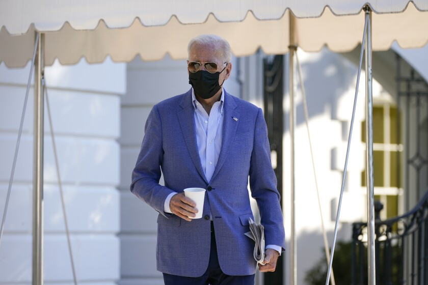 President Joe Biden walks over to speak with members of the press before boarding Marine One on the South Lawn of the White House, Saturday, Oct. 2, 2021, in Washington. Biden is spending the weekend at his home in Delaware. (AP Photo/Patrick Semansky)