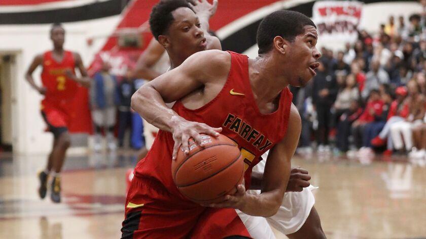 LOS ANGELES, CALIF. - JAN. 25, 2019. Fairfax guard Riobert McRae drives to the basket against Westc