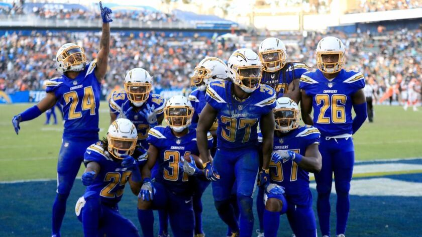 A fourth-quarter fumble recovery against the Cleveland Browns leads to a Chargers celebration at StubHub Center on Sunday.