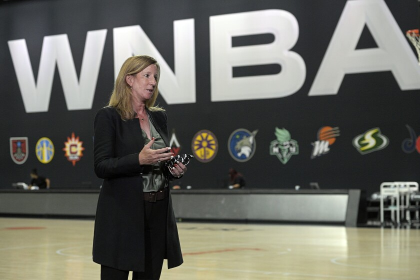 FILE - In this Sunday, Sept. 20, 2020, file photo, WNBA Commissioner Cathy Engelbert answers questions about a postponed game between the Seattle Storm and the Minnesota Lynx after Game 1 of a WNBA basketball semifinal round playoff game between the Connecticut Sun and the Las Vegas Aces, in Bradenton, Fla. The WNBA and the Players' Association have agreed to an opt-in process for this season's draft, the league confirmed to The Associated Press, late Sunday, March 7, 2021. (AP Photo/Phelan M. Ebenhack, File)