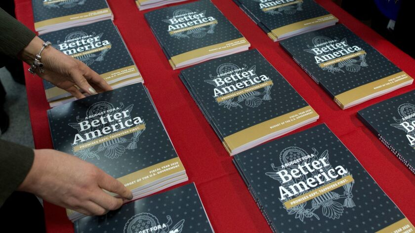 Government Publishing Office employees lay out copies of President Trump's budget for the fiscal year 2020 in Washington on March 11.