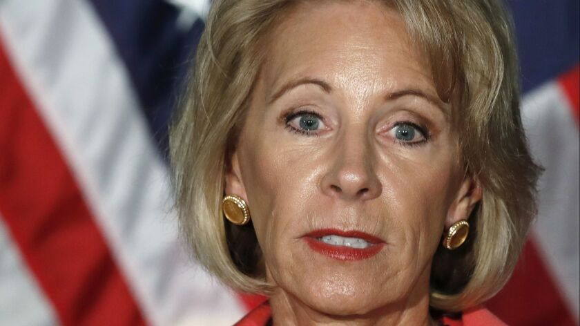 The family of Education Secretary Betsy DeVos, shown in September 2017, owns 10 vessels, including the 163-foot Seaquest.