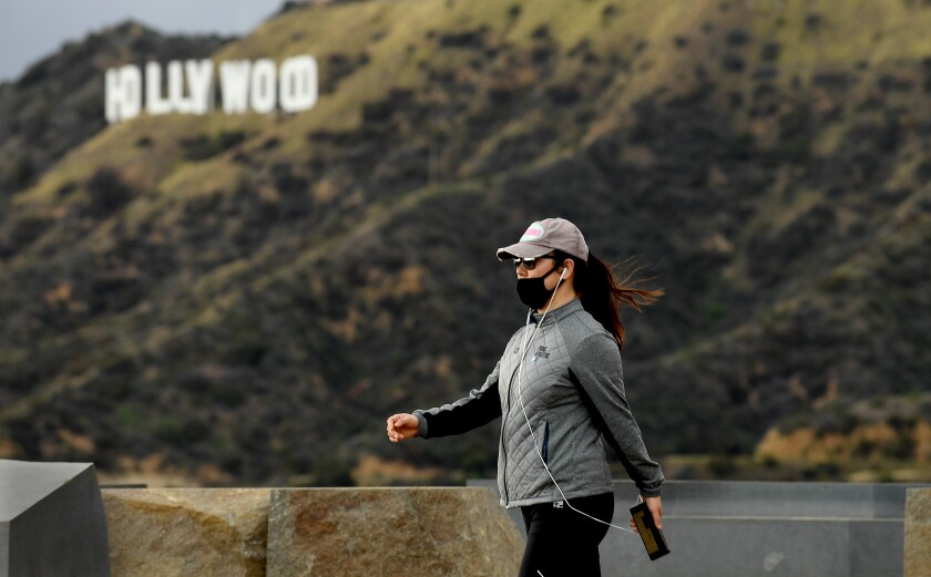 A woman hikes in Griffith Park on Monday