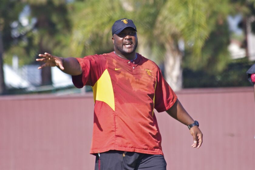 USC assistant Tee Martin shouts instruction to his wide receivers group during practice in 2015.