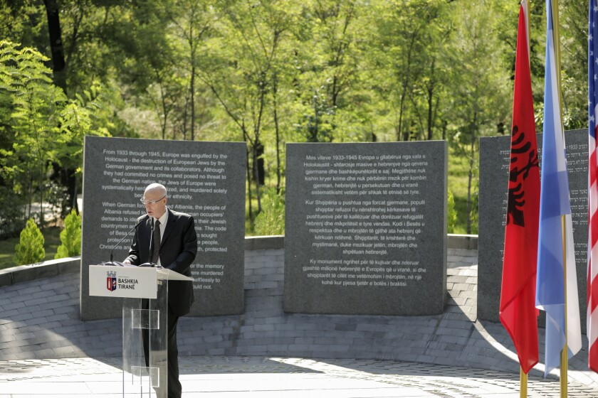 Israeli Ambassador in Albania Noah Gal Gendler speaks during the inauguration of a memorial in Tirana , on Thursday, July 9, 2020. A memorial to the six million Jews murdered during the World War II and for the Albanians who protected them from the Nazis was inaugurated Thursday in the capital. (Xhulio Hajdari /Tirana City Hall via AP)