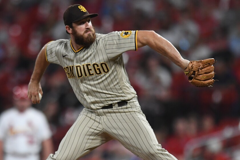 Austin Adams pitches in the eighth inning Friday against the St. Louis Cardinals.