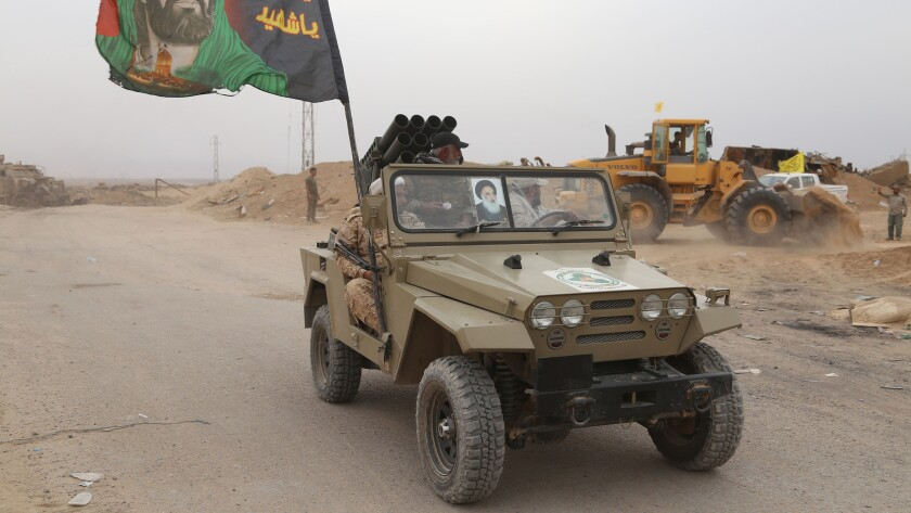 Iraqi forces patrol in Baiji on Oct. 20, 2015, after the government retook control of the oil refinery complex from Islamic State extremists.