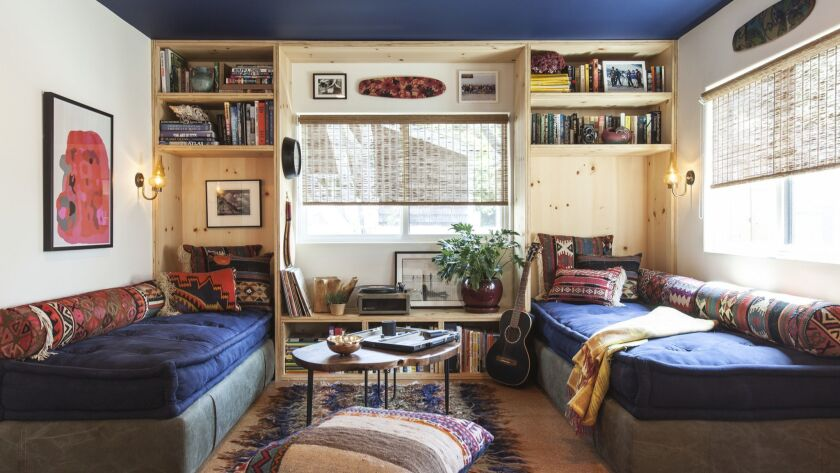 A mobile home in Malibu's Paradise Cove, was renovated by Commune Design to include custom plywood b