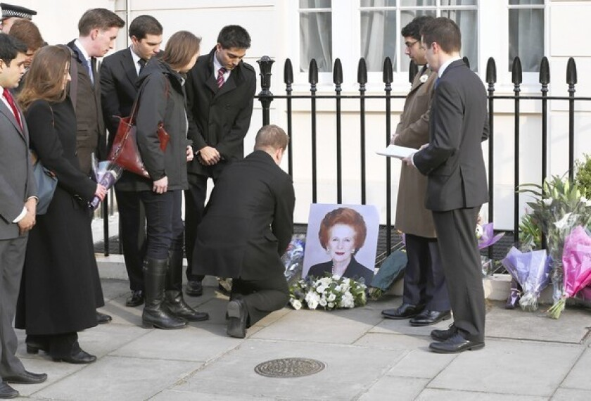 People pay their respects to former Prime Minister Margaret Thatcher outside her residence in Chester Square in London.