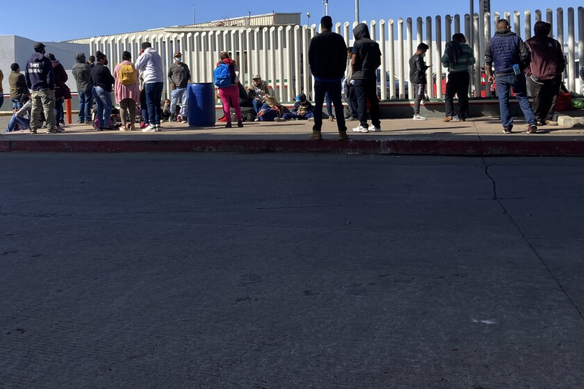 Migrants at a border crossing in Tijuana in February.