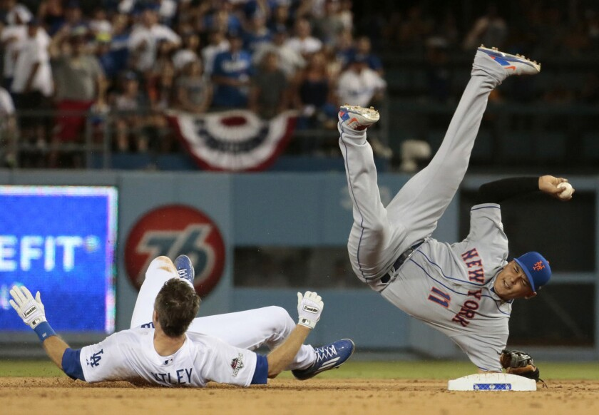 Chase Utley upends Ruben Tejada to break up a seventh inning double play during Game 2 of the National League Division Series on Oct. 10 at Dodger Stadium.