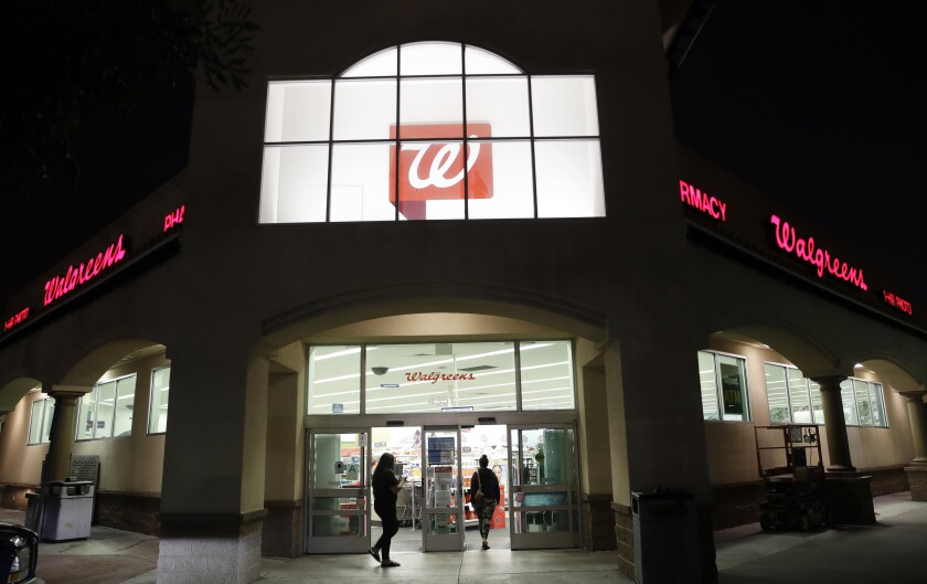 FILE - In this June 24, 2019 file photo, shoppers enter a Walgreens store in Los Angeles. Lawsuits filed by two Ohio counties against retail pharmacy chains CVS, Walgreens, Rite Aid, Walmart and Giant Eagle claiming their opioid dispensing practices flooded communities with pain pills and were a a public nuisance can continue after U.S. District Judge Dan Polster, a federal judge in Cleveland, denied the chains' motion to dismiss the complaints in a ruling Thursday, Aug. 6, 2020. (AP Photo/Marcio Jose Sanchez, File)