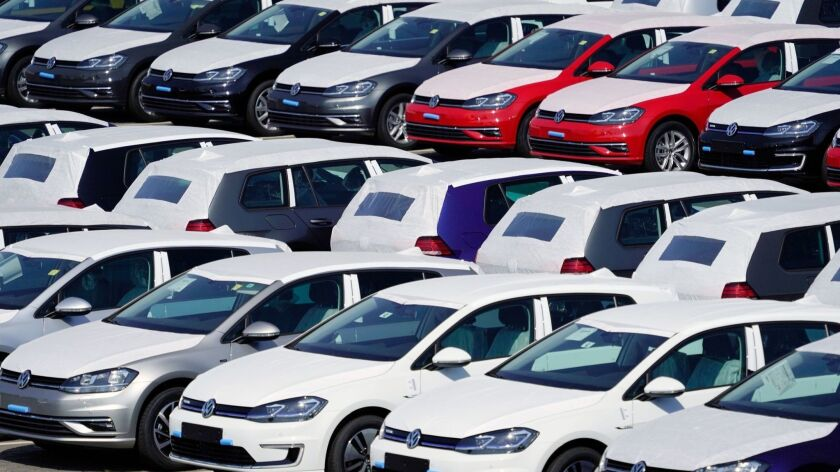 Volkswagen cars are parked near the Berlin Brandenburg Airport in August.