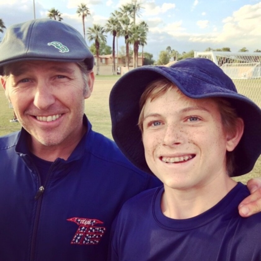 Nick Wallace (right) and his TEAM12 lacrosse coach Tom DeMaio.