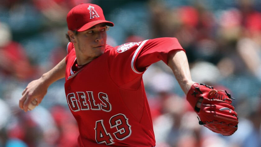 Angels starter Garrett Richards delivers a pitch during the team's 4-3 win over the Kansas City Royals on Sunday afternoon.
