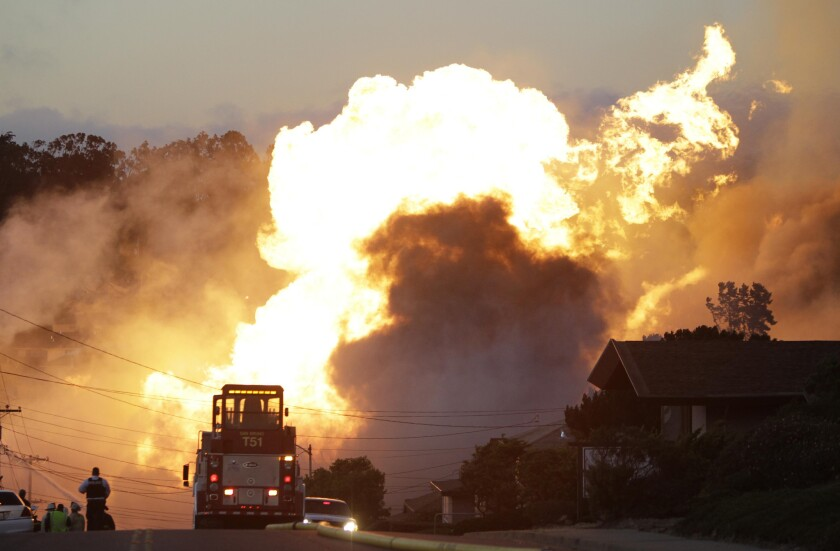 A massive fire roars through a mostly residential neighborhood in San Bruno, Calif., in a 2010 gas pipeline explosion that killed eight people.