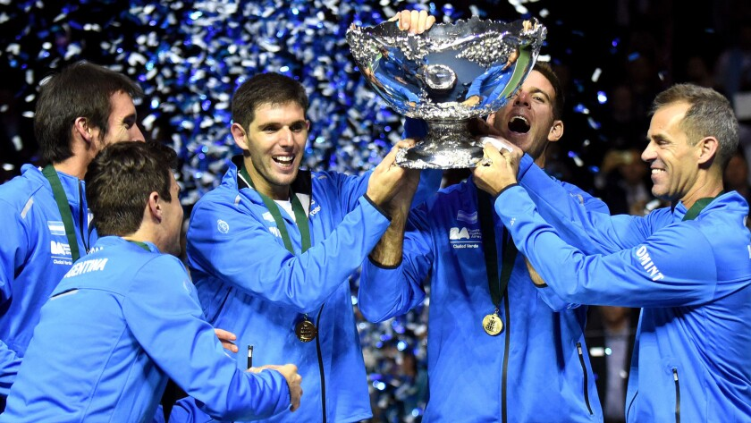 Argentina players (from left) Leonardo Mayer, Guido Pella, Federico Delbonis and Juan Martin del Potro celebrate with Coach Daniel Orsanic, right, after winning the Davis Cup final on Sunday.