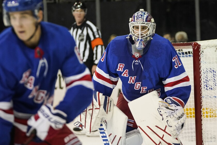 New York Rangers goaltender Igor Shesterkin (31) protects the net during the third period of the team's NHL preseason hockey game against the New Jersey Devils on Wednesday, Oct. 6, 2021, in New York. (AP Photo/Frank Franklin II)