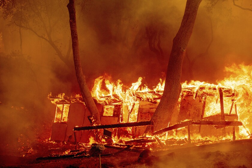 Flames consume a cabin at the Nichelini Family Winery in Napa County.