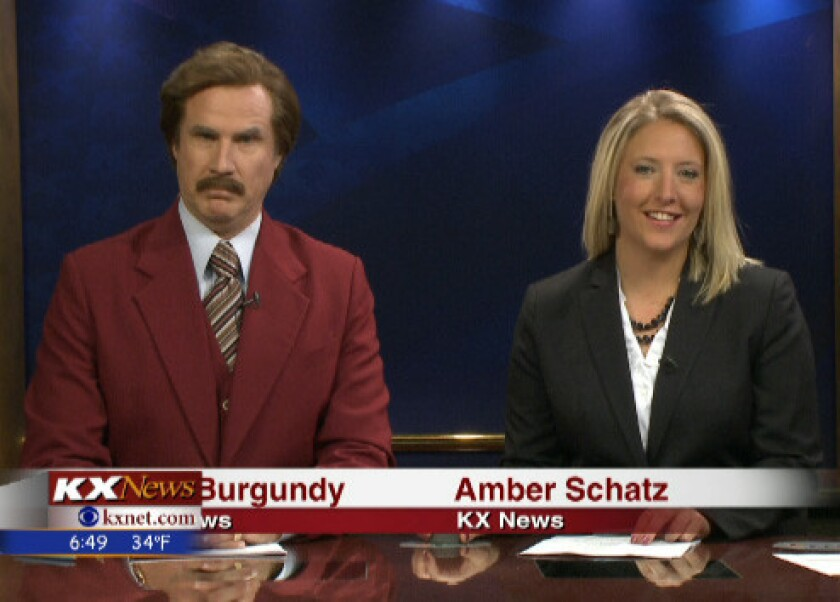 "In this screen grab provided by television station KXMB in Bismarck, N.D., Will Ferrell, as his ""Anchorman"" character Ron Burgundy, co-anchors the evening news with Amber Schatz."