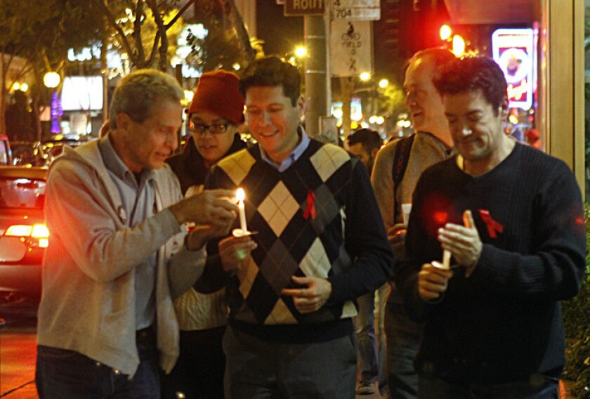Ed Buck, left, gathers with Hernan Molina and West Hollywood Councilman John Duran at a candlelight vigil in West Hollywood in December 2010.