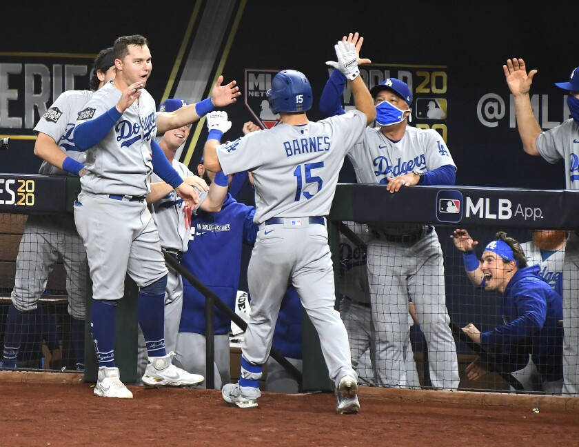 Dodgers manager Dave Roberts greets Austin Barnes after Barnes homered in the sixth inning of Game 3.
