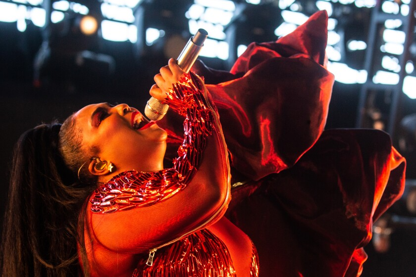 Lizzo is shown performing in April at the 2019 Coachella Valley Music and Arts Festival in Indio. While suffering from a cold at her October concert in San Diego, the singer, rapper and flutist kept the sold-out audience on its feet throughout.