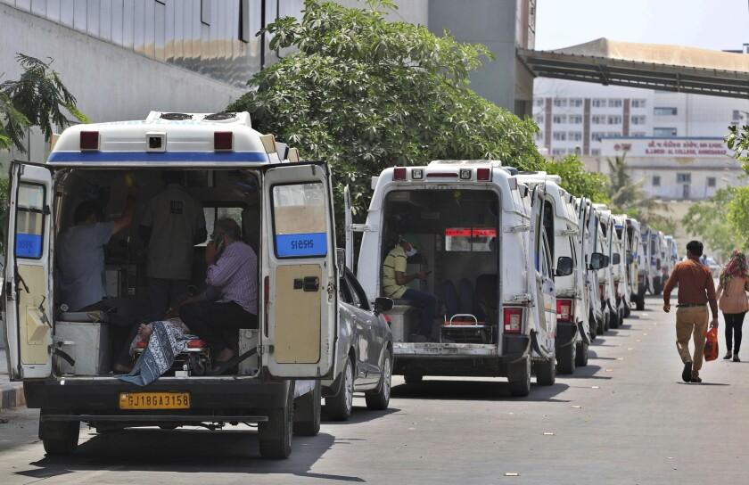 Ambulances carrying COVID-19 patients line up.