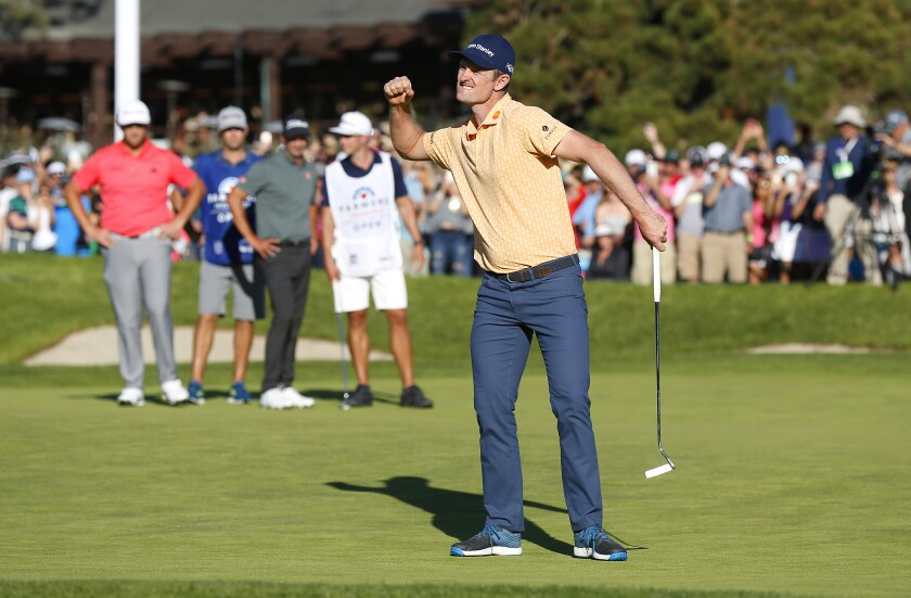 Justin Rose celebrates after a birdie on the 18th hole to win the Farmers Insurance Open at Torrey Pines on Jan. 27, 2019.