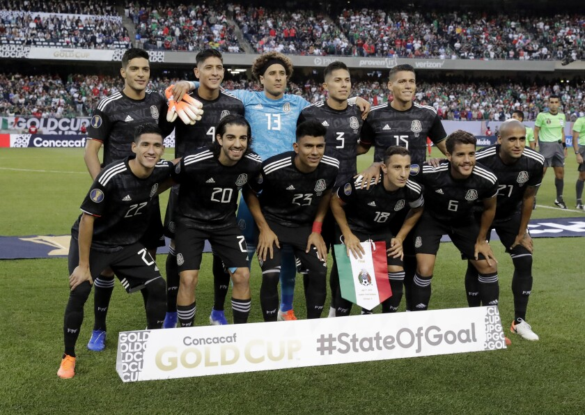 Mexico's soccer team poses on the field
