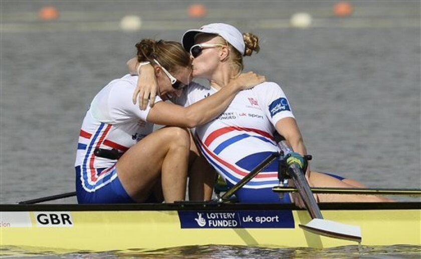 Helen Glover, left, and Polly Swann of England celebrate after winning the women's pair final event of the World Rowing Championships in Chungju, south of Seoul, South Korea, Saturday, Aug. 31, 2013. (AP Photo/Lee Jin-man)