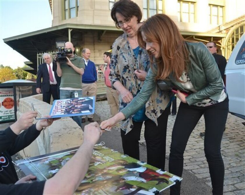 """The """"Office"""" actors, Phyllis Smith and Ellie Kemper, sign autographs outside the Radisson Lackawanna Station Hotel, Friday, May 3, 2013 in Scranton, Pa. The cast and crew are in town for the Office Wrap Party, a day of events celebrating the show and its ties to Scranton as it comes to an end. (AP Photo/Scranton Times & Tribune, Jason Farmer) WILKES BARRE TIMES-LEADER OUT; MANDATORY CREDIT"""
